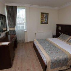 Grand Saatcioglu Hotel Турция, Аксарай - отзывы, цены и фото номеров - забронировать отель Grand Saatcioglu Hotel онлайн комната для гостей