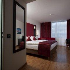 Отель Ramada Encore Geneva Швейцария, Ланси - 1 отзыв об отеле, цены и фото номеров - забронировать отель Ramada Encore Geneva онлайн комната для гостей фото 4