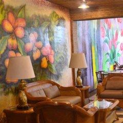 Отель Alfonso Hotel Филиппины, Тагайтай - отзывы, цены и фото номеров - забронировать отель Alfonso Hotel онлайн интерьер отеля фото 2