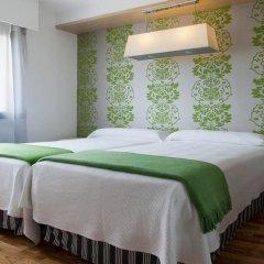 NH Suites Prisma Hotel комната для гостей фото 4
