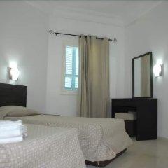 Отель Menzel Dija Appart-Hotel Тунис, Мидун - отзывы, цены и фото номеров - забронировать отель Menzel Dija Appart-Hotel онлайн комната для гостей