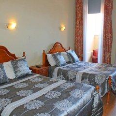 Отель Residencial Henrique VIII сейф в номере