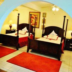 Отель Beachcombers Hotel Сент-Винсент и Гренадины, Остров Бекия - отзывы, цены и фото номеров - забронировать отель Beachcombers Hotel онлайн сейф в номере