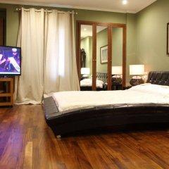 Отель Andromeda Suites and Apartments Греция, Афины - отзывы, цены и фото номеров - забронировать отель Andromeda Suites and Apartments онлайн комната для гостей фото 2