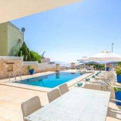 Villa Kiziltas 1 Турция, Калкан - отзывы, цены и фото номеров - забронировать отель Villa Kiziltas 1 онлайн бассейн фото 2