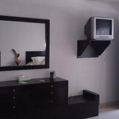 Отель Suites del Real сейф в номере