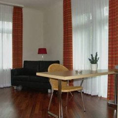 Апартаменты Accademia Apartments Цюрих комната для гостей фото 2