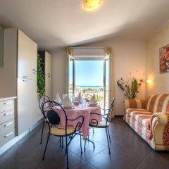 Отель Residence Amarcord Италия, Римини - отзывы, цены и фото номеров - забронировать отель Residence Amarcord онлайн комната для гостей фото 2