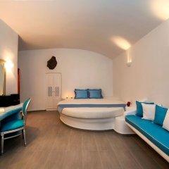Отель Pegasus Suites & Spa Остров Санторини сейф в номере
