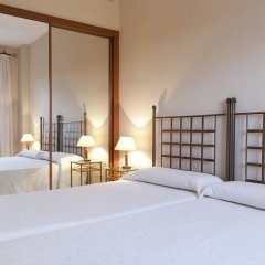 Отель Apartamentos Vértice Bib Rambla Испания, Севилья - отзывы, цены и фото номеров - забронировать отель Apartamentos Vértice Bib Rambla онлайн комната для гостей фото 5