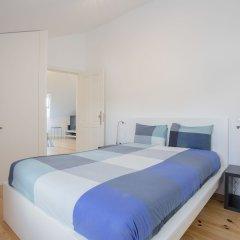 Апартаменты Liiiving - Cosy Downtown Apartments Порту комната для гостей фото 4