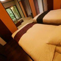 Отель Hatago Sakura Минамиогуни комната для гостей