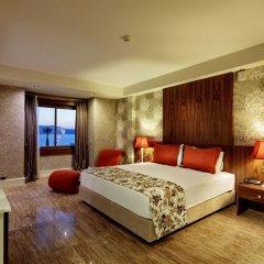 Отель Euphoria Aegean Resort & Spa All Inclusive Сыгаджик комната для гостей фото 4