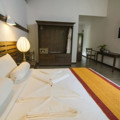 Отель Roman Lake Ayurveda Resort сейф в номере
