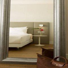Отель NH Collection Brussels Centre сейф в номере