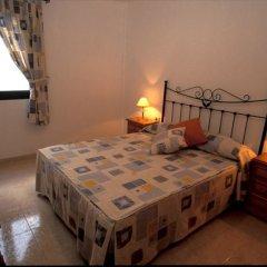 Отель Cala Apartments 3Pax 1A Испания, Гинигинамар - отзывы, цены и фото номеров - забронировать отель Cala Apartments 3Pax 1A онлайн комната для гостей фото 2