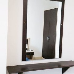Апартаменты Il Cantone del Faro Apartments Таормина сейф в номере