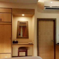 Отель Lanta Sand Resort And Spa Ланта сейф в номере