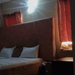 Отель Dcove Hotel & Suites Нигерия, Лагос - отзывы, цены и фото номеров - забронировать отель Dcove Hotel & Suites онлайн комната для гостей фото 5
