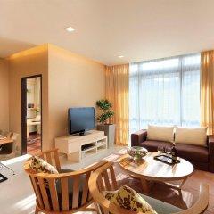 Отель PARKROYAL Serviced Suites Kuala Lumpur Малайзия, Куала-Лумпур - 1 отзыв об отеле, цены и фото номеров - забронировать отель PARKROYAL Serviced Suites Kuala Lumpur онлайн комната для гостей фото 3