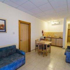 Апартаменты Damiani Apartments комната для гостей