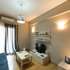 Апартаменты Luxury Cozy Apartment near Acropolis комната для гостей фото 4