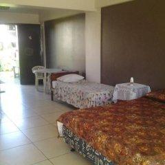 Отель Travellers Beach Resort комната для гостей фото 4
