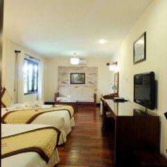 Отель Vinh Hung Riverside Resort & Spa Вьетнам, Хойан - отзывы, цены и фото номеров - забронировать отель Vinh Hung Riverside Resort & Spa онлайн комната для гостей фото 3
