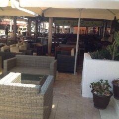 Отель Kokkinos Hotel Apartments Кипр, Протарас - отзывы, цены и фото номеров - забронировать отель Kokkinos Hotel Apartments онлайн интерьер отеля
