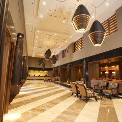 Отель Omni Cancun Hotel & Villas - Все включено Мексика, Канкун - 1 отзыв об отеле, цены и фото номеров - забронировать отель Omni Cancun Hotel & Villas - Все включено онлайн интерьер отеля фото 4