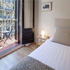 Апартаменты Habitat Apartments Boulevard Барселона комната для гостей фото 4