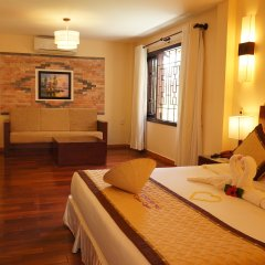 Отель Vinh Hung Riverside Resort & Spa комната для гостей фото 4