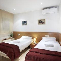 Отель Apartamentos Calvet Испания, Барселона - отзывы, цены и фото номеров - забронировать отель Apartamentos Calvet онлайн комната для гостей фото 4
