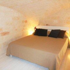 Отель Typical Apulian Apartment Италия, Бари - отзывы, цены и фото номеров - забронировать отель Typical Apulian Apartment онлайн комната для гостей фото 4