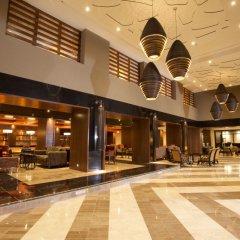 Отель Omni Cancun Hotel & Villas - Все включено Мексика, Канкун - 1 отзыв об отеле, цены и фото номеров - забронировать отель Omni Cancun Hotel & Villas - Все включено онлайн интерьер отеля фото 3