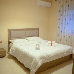 Апартаменты Choose Balkans Apartments Тирана комната для гостей фото 5