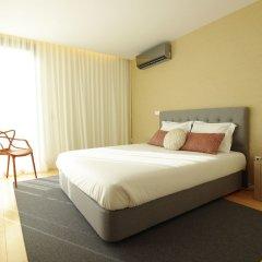 Апартаменты Deluxe Populo Beach Apartments комната для гостей фото 5