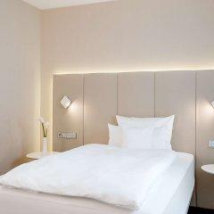 Отель NH Collection Frankfurt City комната для гостей фото 3