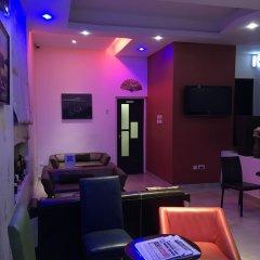 Отель Millennium Apartments Нигерия, Лагос - отзывы, цены и фото номеров - забронировать отель Millennium Apartments онлайн гостиничный бар