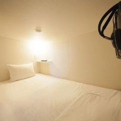 Отель Capsule and Sauna Oriental Япония, Токио - отзывы, цены и фото номеров - забронировать отель Capsule and Sauna Oriental онлайн комната для гостей фото 2