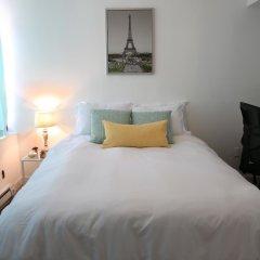 Отель NY079 1 Bedroom Apartment By Senstay США, Нью-Йорк - отзывы, цены и фото номеров - забронировать отель NY079 1 Bedroom Apartment By Senstay онлайн комната для гостей фото 2