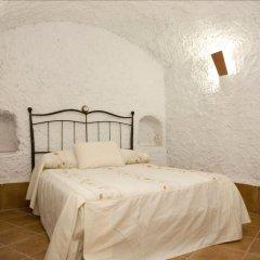 Отель Cuevalia. Alojamiento Rural En Cueva Сьерра-Невада комната для гостей фото 2