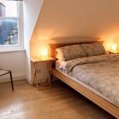 Отель 1 Bedroom Penthouse Apartment On Royal Mile Великобритания, Эдинбург - отзывы, цены и фото номеров - забронировать отель 1 Bedroom Penthouse Apartment On Royal Mile онлайн комната для гостей фото 3