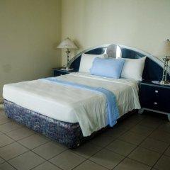 Отель Skymiles Beach Suite At Montego Bay Club Resort Ямайка, Монтего-Бей - отзывы, цены и фото номеров - забронировать отель Skymiles Beach Suite At Montego Bay Club Resort онлайн комната для гостей