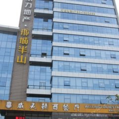 Zhuoyue Business Hotel вид на фасад