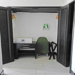 Áurea Hotel & Suites сейф в номере