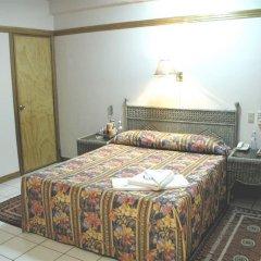 Отель Orchid Inn Resort Филиппины, Пампанга - отзывы, цены и фото номеров - забронировать отель Orchid Inn Resort онлайн комната для гостей фото 2
