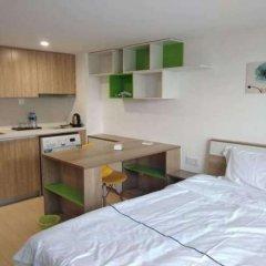 Апартаменты Tengsen Apartment Wanke Yuncheng Branch комната для гостей фото 3