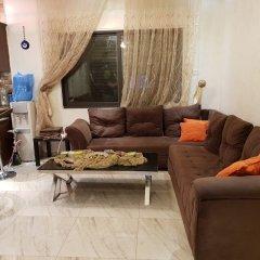 Отель Abdoun Hills Apartment Иордания, Амман - отзывы, цены и фото номеров - забронировать отель Abdoun Hills Apartment онлайн интерьер отеля