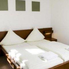 Отель Pension Lugano Мюнхен комната для гостей